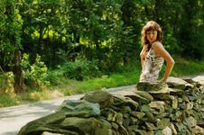 Free Pretty Girl Next To Stone Fence Stock Photography - 5802022