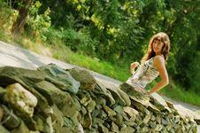 Pretty Girl Next To Stone Fence Royalty Free Stock Photo