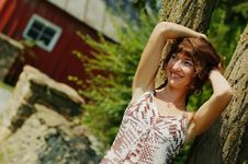 Girl Leaning Against Tree Stock Photography