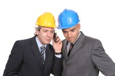 Two Engineers Or Architects, On The Phone Royalty Free Stock Photos