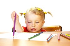 Cute Little Girl And Pencils Stock Photos