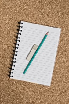 Spiral Notepad On Cork Royalty Free Stock Image