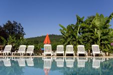 Sunloungers By The Swimming Pool Royalty Free Stock Photos