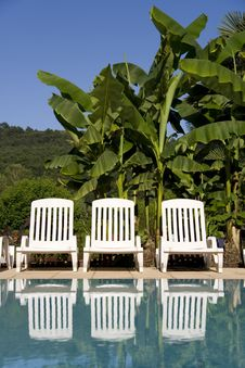 Free Sunloungers By The Swimming Pool Stock Photos - 5807223