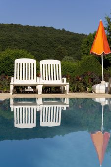 Sunloungers By The Swimming Pool Stock Photo