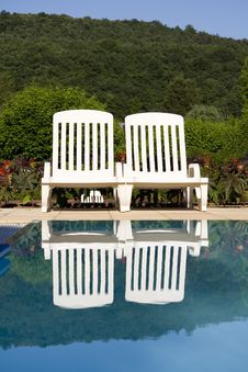 Sunloungers By The Swimming Pool Royalty Free Stock Image
