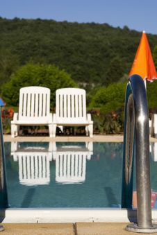 Free Sunloungers By The Swimming Pool Stock Photography - 5807262