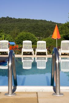 Free Sunloungers By The Swimming Pool Royalty Free Stock Photo - 5807285
