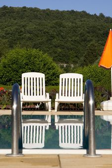 Free Sunloungers By The Swimming Pool Royalty Free Stock Image - 5807346