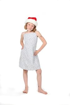 Cute Girl In Dress And Santa Hat Stock Photos