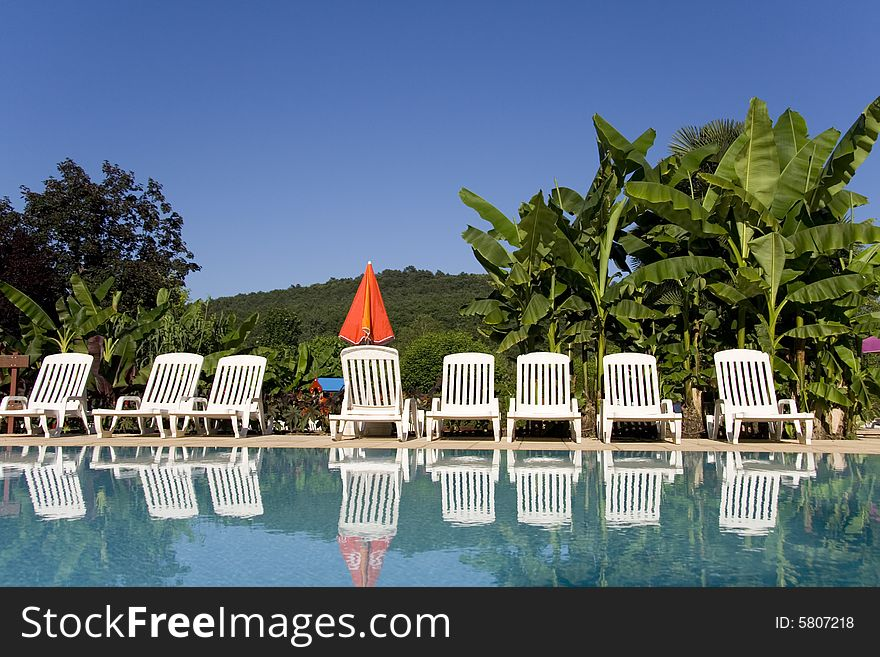 Sunloungers by the swimming pool