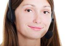 Free Cute Brunette With A Headset Stock Image - 5811451