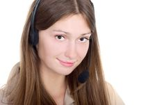 Free Cute Brunette With A Headset Royalty Free Stock Photography - 5811477