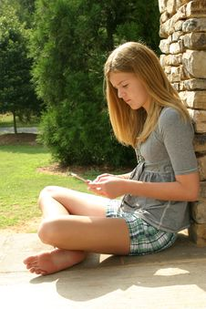 Free Teenage Girl Using Cell Phone Royalty Free Stock Photo - 5816275