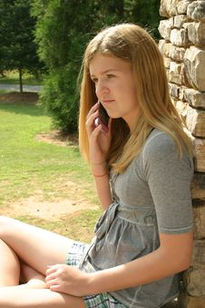 Free Teenage Girl Using Cell Phone Stock Photo - 5816290