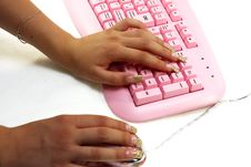 Hands Of The Girl On Keyboard And Mouse Stock Photos