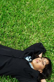Free Businesswoman Napping On Grass Royalty Free Stock Photos - 5817248