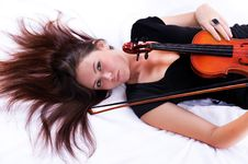 Girl With Violin Laying On Floor Stock Image