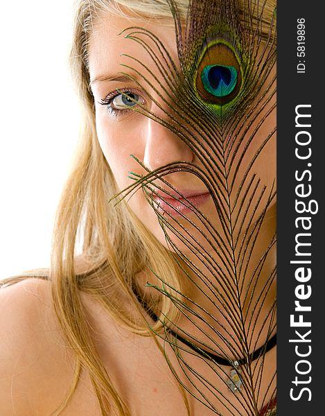 Beautiful girl, peacock a feather closes eye
