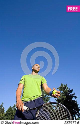Free Man On Tennis Court Holding Racket Royalty Free Stock Image - 5829716