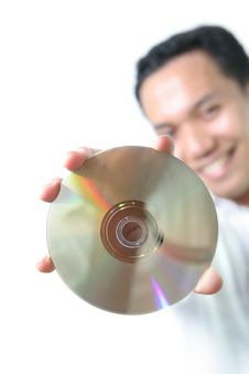 Free Man With Optical Disc Storage Royalty Free Stock Image - 5820216