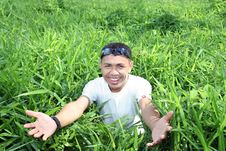 Free Man In Green Field Royalty Free Stock Photography - 5820227