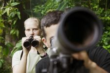 Pretty Woman With Binoculars And Man With Telescop Royalty Free Stock Photography