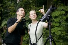 Pretty Woman With Binoculars And Man With Telescop Stock Photo