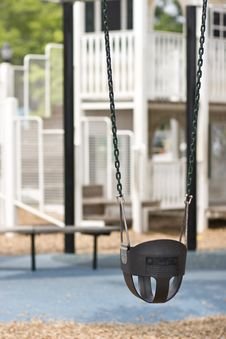 Free Infant Swing On Playground Royalty Free Stock Photo - 5820775
