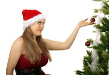 Free Mrs Santa Looking At Christmas Tree Royalty Free Stock Photo - 5822785
