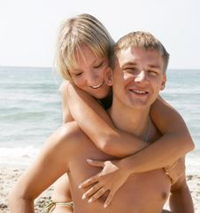 Young Couple On Beach Stock Images