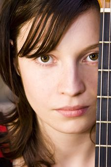 Woman Behind Fretboard Stock Photo