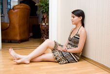Free The Girl Sits On A Floor Of A Room At A Wall Stock Photography - 5826032