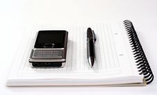 Mobile Phone Pen And Spiral Notepad Stock Photos