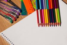 Colored Pencils, Pens, A Ruler With A White Notebook Stock Images