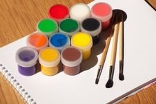 Set Of Watercolor Paints And Brushes Stock Photos
