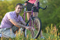 Free Man Fixing A Bike - Horizontal Stock Image - 5831481
