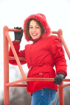 Pretty Woman On Metallic Ladder In Winter Royalty Free Stock Image