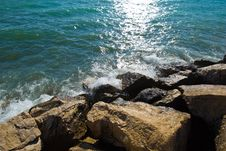 Waves On Stones Royalty Free Stock Images