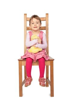 Free Girl With Toy Sitting On Stool Stock Images - 5830534