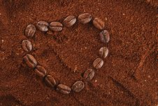 Free Coffee Beans In Heart Shape And Ground Background Royalty Free Stock Photography - 5830537