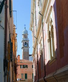 Dome Of Bell Tower Behind An Old Roofs. Royalty Free Stock Photo