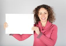 Young Woman Keeps White Sheet Of Paper Royalty Free Stock Photos