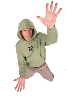 Free Man In Jacket With Hood Is Kneeling Stock Photos - 5831113