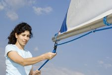 Free Woman Fixing Sail On Sailboat - Horizontal Stock Image - 5831311