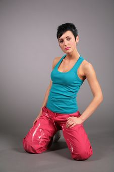 Woman In Sportswear Sits In Lap Royalty Free Stock Photography