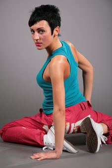 Woman In Sportswear Sits In Lap With Side Stock Photography