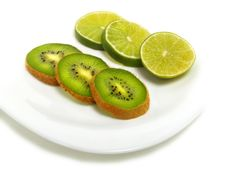 Sliced Lime And Kiwi On Plate Stock Photography