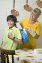 Free Woman Filling Boy S Backpack - Vertical Royalty Free Stock Photos - 5849468