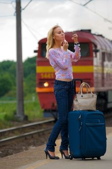 Free Young Lady Waiting A Train Stock Photo - 5840440